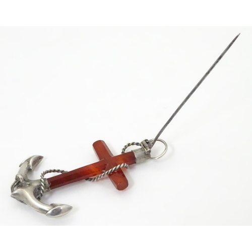 572 - A Victorian brooch formed as an anchor set with carnelian and white metal detail. 3