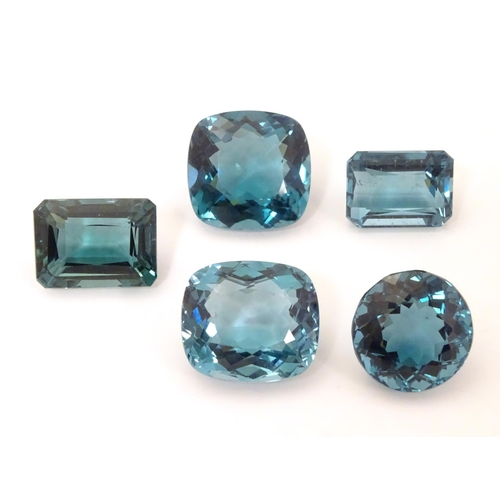 576 - Assorted aquamarine coloured stones . Unmounted. The largest approx 3/4