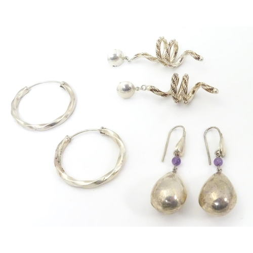 582 - 3 pairs of assorted silver and white metal drop earrings. Approx 2