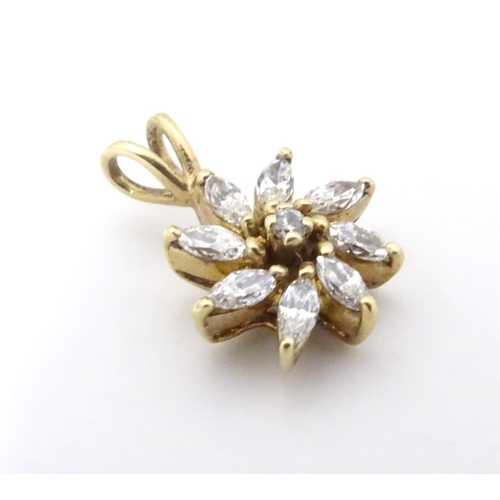591 - A 9ct gold pendant of flower form set with white stones. 3/4