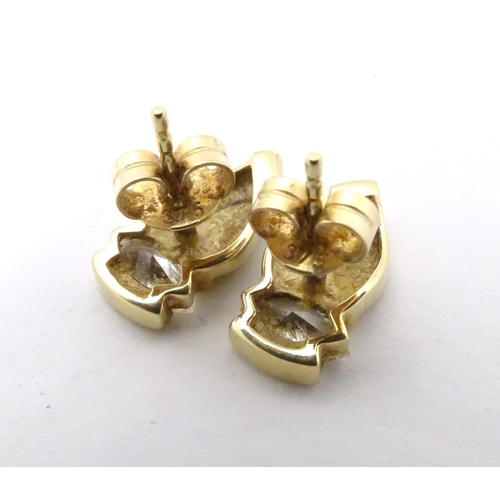592 - A pair of 9ct gold stud earrings set with white stones
