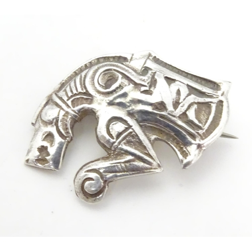 597 - An unusual silver brooch formed as a mythical dragon / horse creature. Possibly Scandinavian 1 1/4