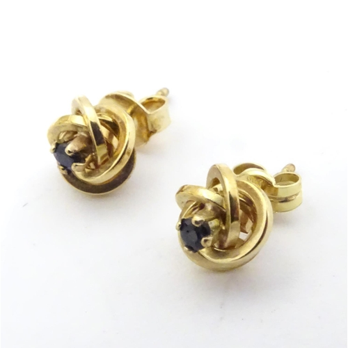 600 - A pair of 9ct gold stud earrings set with blue stones 1/ 4