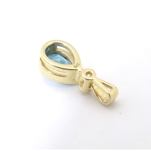 610 - A 9ct gold pendant set with blue topaz 1/2