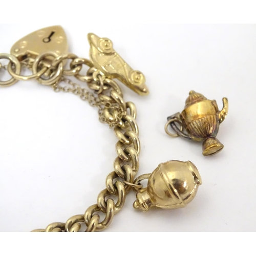 617 - A 9ct gold charm bracelet set with various 9ct gold charms