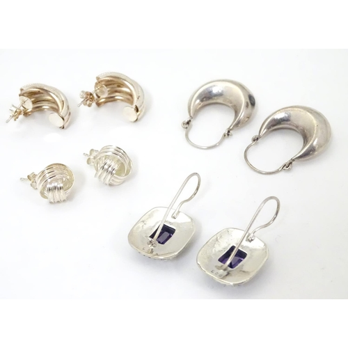627 - Four assorted pairs of silver and white metal earrings.