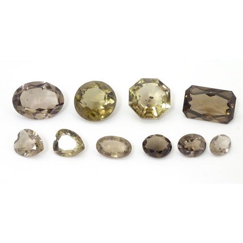628 - Assorted facet cut smoky quartz stones. unmounted.  The largest approx 1