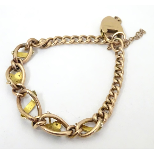 629 - A 9ct gold bracelet set with seed pearl and turquoise in a shamrock setting