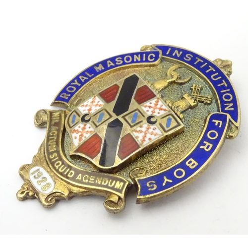 649 - A hallmarked silver Masonic fob / jewel, the obverse decorated in gilt and enamel with the insignia ...