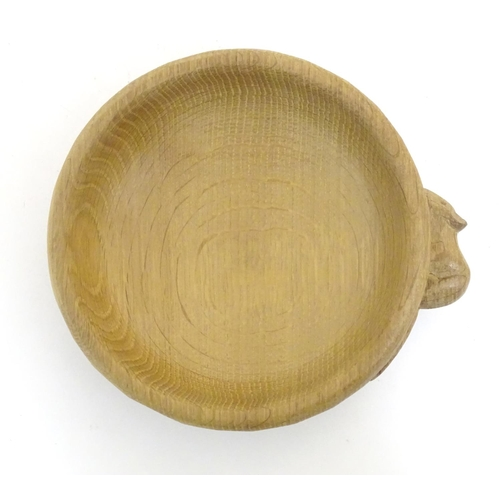 1123 - A Robert Thompson of Kilburn / Mouseman (1876-1955) oak nut bowl with an adzed exterior with carved ...