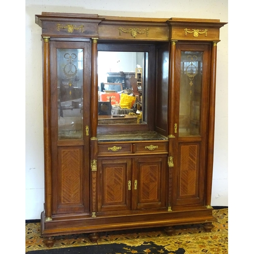 1385 - A mid 20thC continental mahogany cabinet having a recessed mirror back with grey marble top over two...