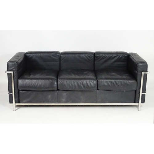1565B - A mid 20thC chrome and leather Le Corbusier LC3 sofa. 70