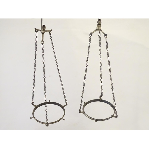 894 - A pair of Arts & Crafts hanging / pendant light frames in the manner of WAS Benson. Approx. 7
