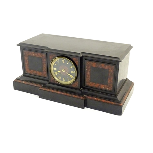 922 - Clock: a large 19thC black and red marble mantel clock, of break front form, 18 5/8