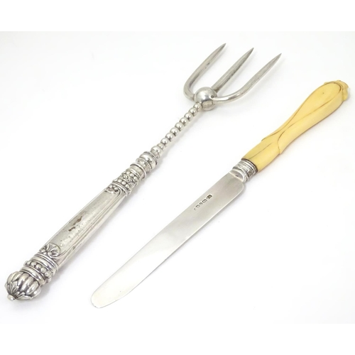 473 - A butter knife with silver blade hallmarked Sheffield 1853 maker John Oxley together with a silver p...