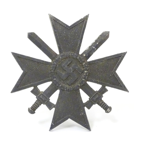 664 - Militaria: a WWII/WW2/Second World War German War Merit Cross ('Kriegsverdienstkreuz') badge, 1 7/8