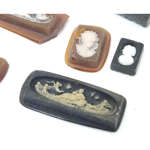 640 - A quantity of assorted cameo intaglios etc depicting various classical scenes.  etc The largest appr...