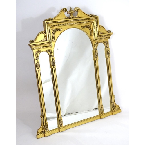 1400 - A mid 20thC giltwood mirror with a rosette carved swans neck pediment and an urn to the centre. Havi...