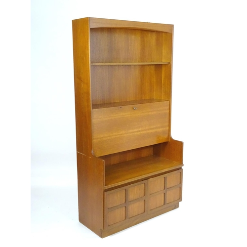 1567 - Vintage retro, mid-century: a 1970s teak wall board bureau bookcase by Nathan Furniture, comprising ...