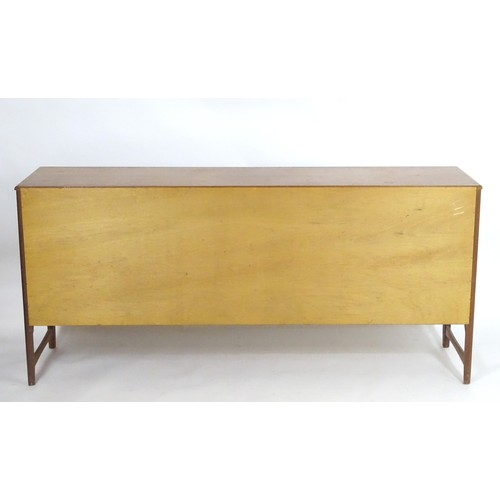 1566 - Vintage retro, mid-century: a 1970s teak sideboard by Nathan Furniture, composed of three cupboards ...