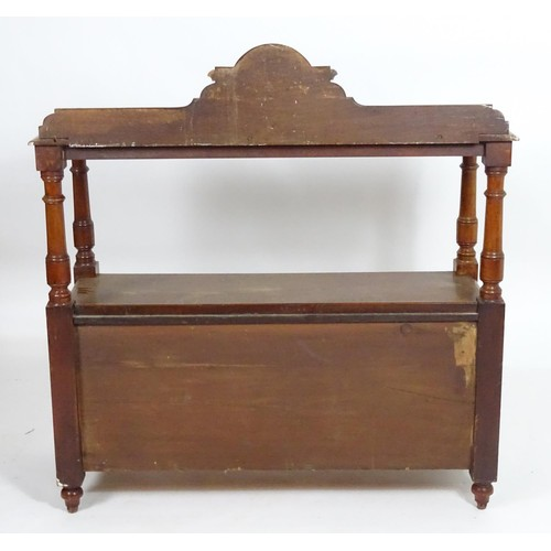 1399 - A 19thC mahogany buffet with a shaped upstand above four turned tapering supports and two panelled c...