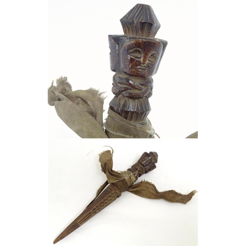 952 - Ethnographic / Native / Tribal: A wooden carving of stylised dagger form with three carved faces to ...