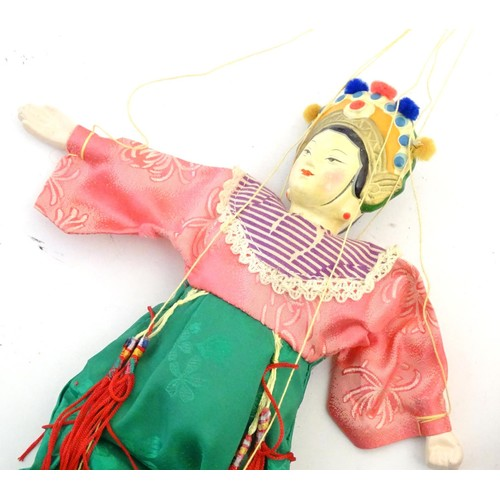 865A - A quantity of Oriental dolls, the majority with composite and papier mache heads, hands and feet. To...