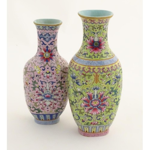 6 - A Chinese famille rose double vase, joined at the shoulder. Each decorated with doucai style scrolli...