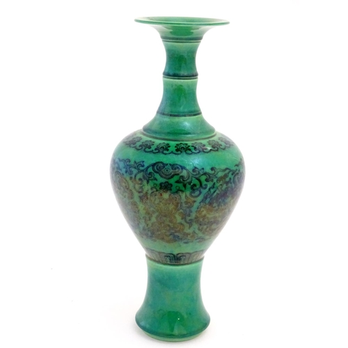 22 - A Chinese footed bulbous vase with a flared rim, the body decorated with scrolling dragon roundels a...