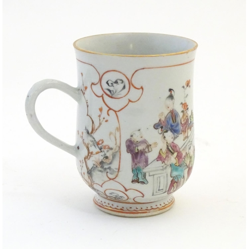 2 - A Chinese export famille rose mug / tankard decorated with figures in a domestic interior scene, and...