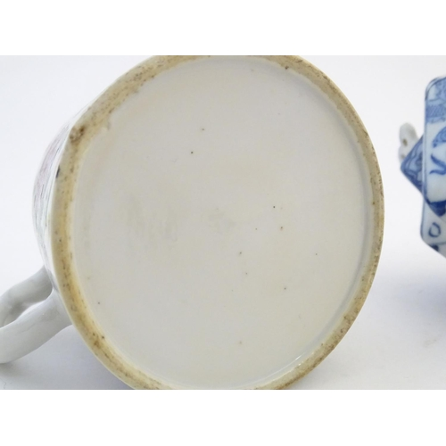 34 - Two Chinese teapots comprising a blue and white example with a geometric body decorated with stylise...