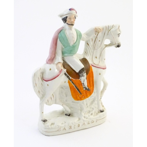 57 - A Staffordshire pottery equestrian flat back depicting Garibaldi on horseback, titled to base. Appro...
