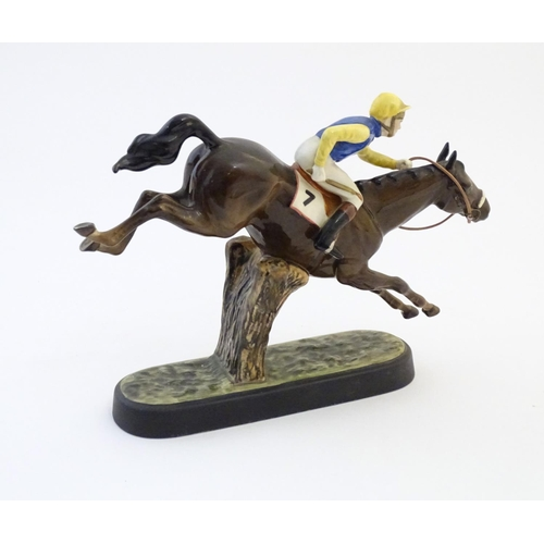 161 - A Beswick model of a seated jockey and race horse, Steeplechaser, model no. 2505. Marked under. Appr...