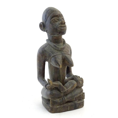 1690 - Ethnographic / Native / Tribal: A carved Congo model of a seated woman and child. Approx. 16