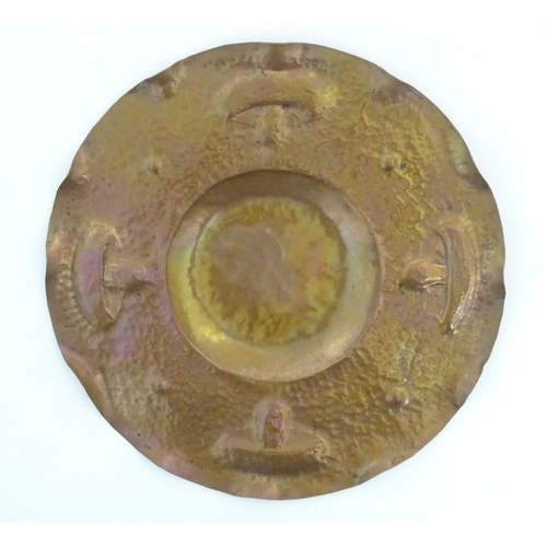 1011 - An Arts & Crafts hammered copper tray of circular form with mushroom / fungi detail in the Newlyn Sc...