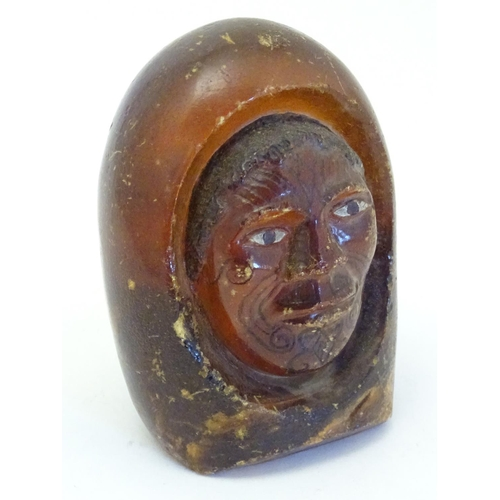 1114 - A Maori carved resin model of the head of a man with painted eyes and Moko facial tattoos. Approx. 4...