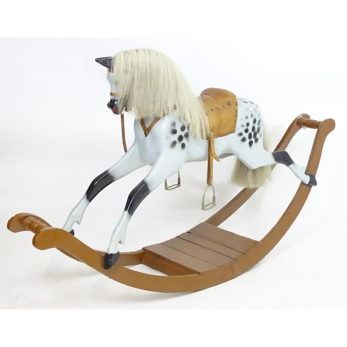 977 - Toy: A late 19th / early 20thC dapple grey rocking horse with horse hair mane and tail, on bow rocke...