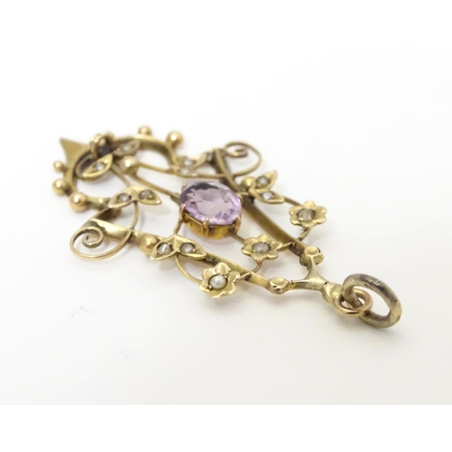 599 - A 9ct gold pendant set with amethyst and seed pearls 1 1/2