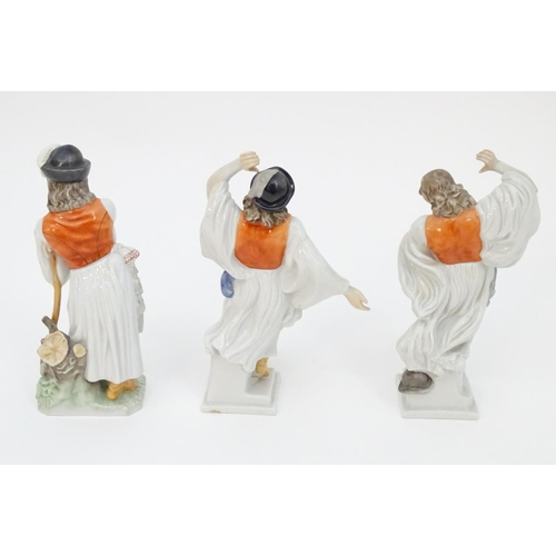 221 - Three Herend pottery figures modelled as two dancing cowboys and a mournful shepherd. Marked under. ...