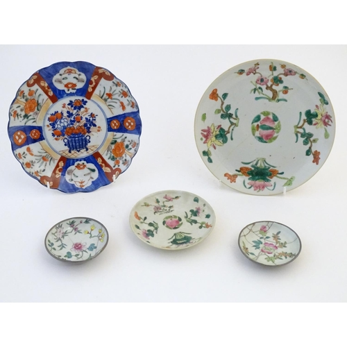 34 - Five assorted Oriental plates to include famille rose plates with floral and foliate detail, each ma...