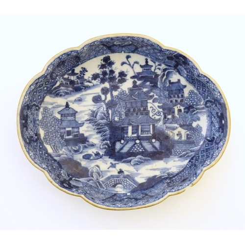 54 - An Oriental blue and white plate with stylised peony detail, and stylised scrolling flower motifs to...