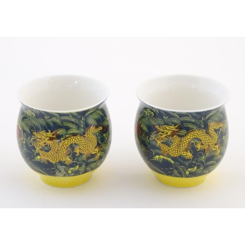 13 - Two Chinese tea bowls of bulbous form with flared rims, with dragon and flaming pearl decoration. Ch...