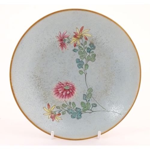 24 - A Chinese plate with stylised peony flower detail. Character marks under. Approx. 6