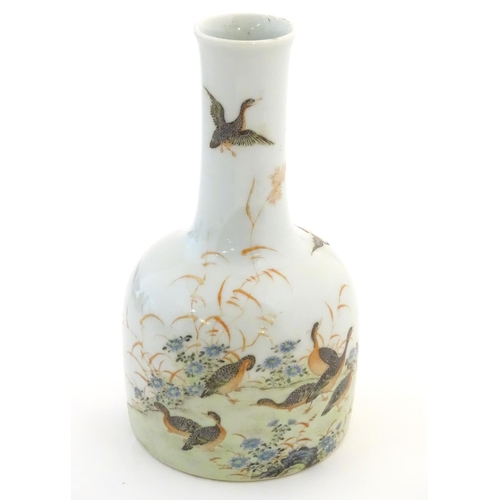26 - A Chinese bottle vase decorated with a landscape scene with ducks / birds. Character marks under. Ap...