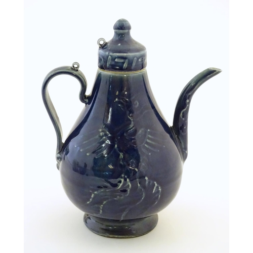 30 - A Chinese pear shaped teapot with phoenix bird decoration to body. Approx. 8 3/4