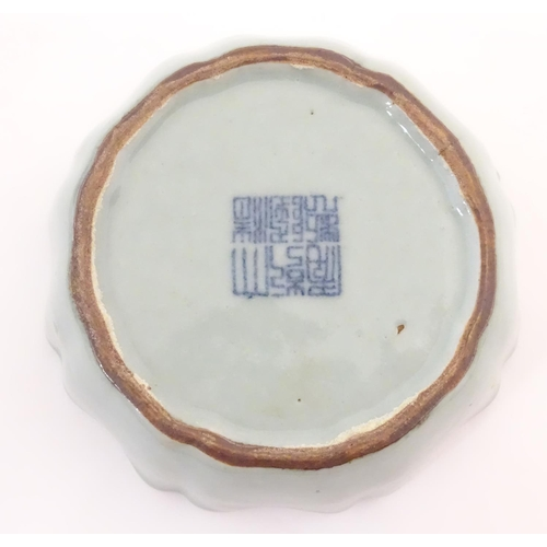 31 - A Chinese celadon brush wash pot with a scalloped edge. Character marks under. Approx. 1 1/2