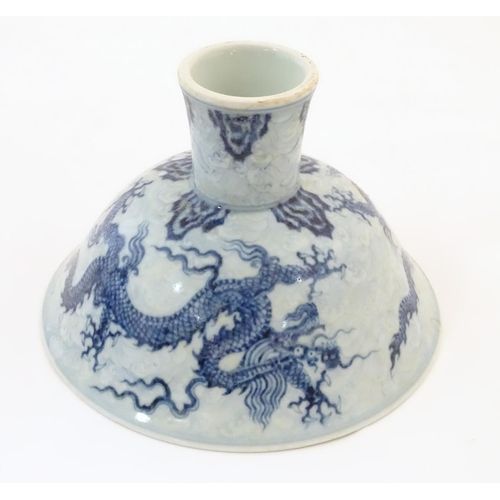 33 - A Chinese blue and white dragon stem bowl with a raised foot. The bowl decorated with two dragons am...