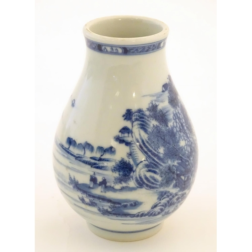 35 - A Chinese blue and white vase decorated with a landscape scene with mountains, pagodas, figures in b...