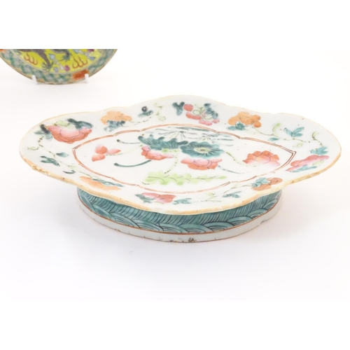 44 - Three Oriental items, comprising a plate with a yellow ground decorated with dragons and a flaming p...