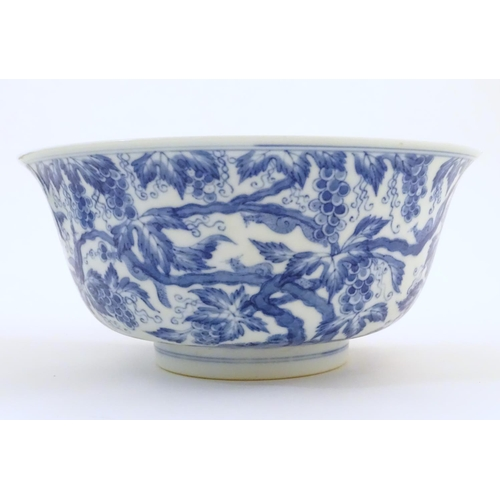 46 - A Chinese blue and white bowl decorated with vine leaves and grapes. Character marks under. Approx. ...